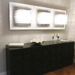 Interior Design München - schwarzes Sideboard mit drei Wandlampen